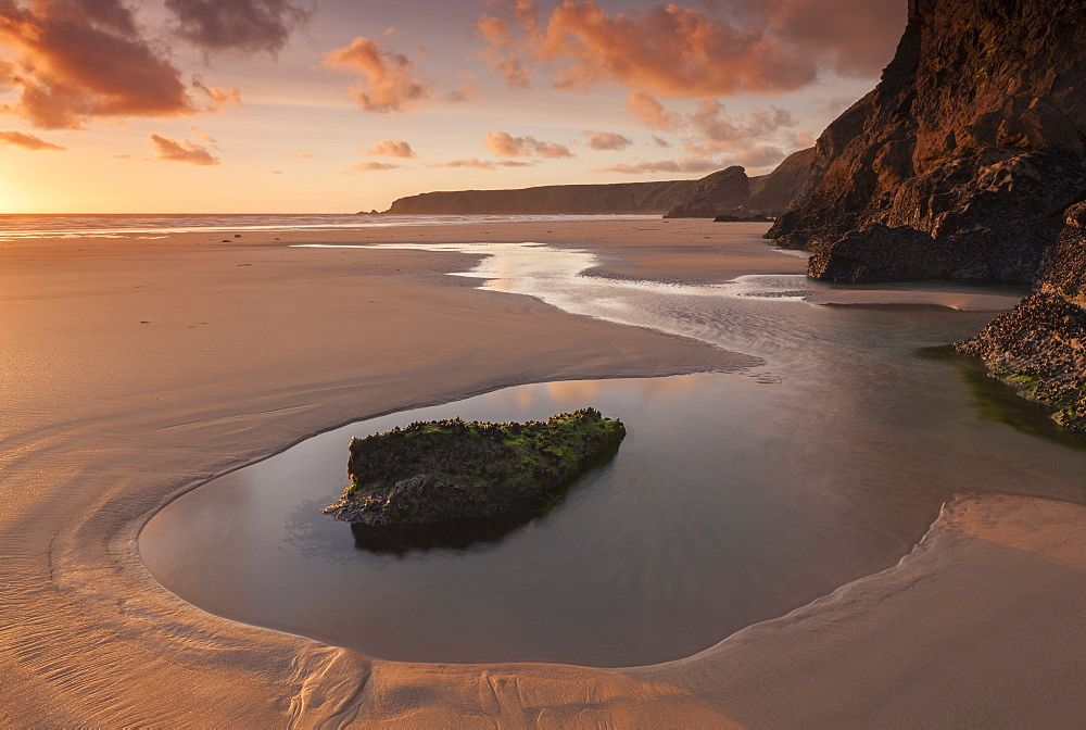 Tidal pools on Bedruthan Steps beach at sunset, Cornwall, England, United Kingdom, Europe
