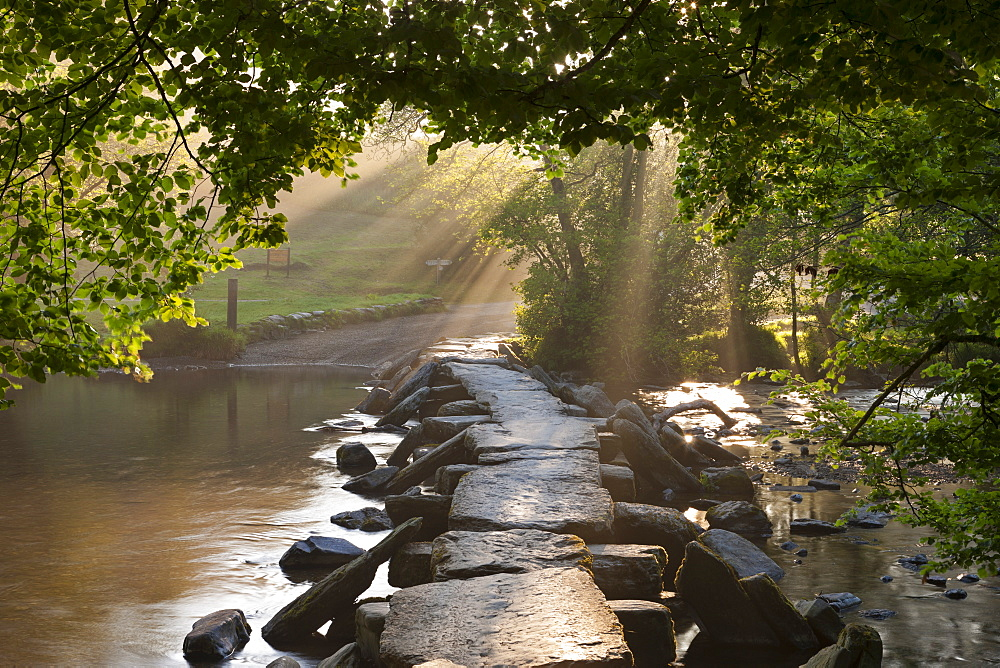 Tarr Steps, an ancient clapper bridge spanning the River Barle, Exmoor National Park, Somerset, England, United Kingdom, Europe