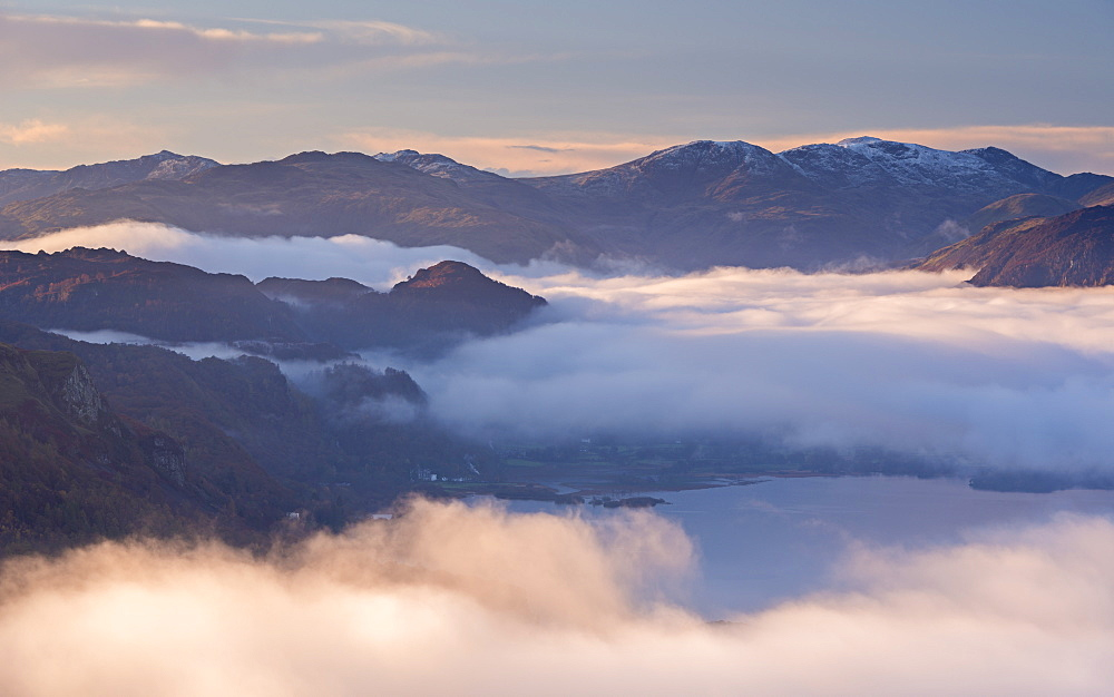 Early morning mist hangs above Derwent Water in autumn, Lake District National Park, Cumbria, England, United Kingdom, Europe