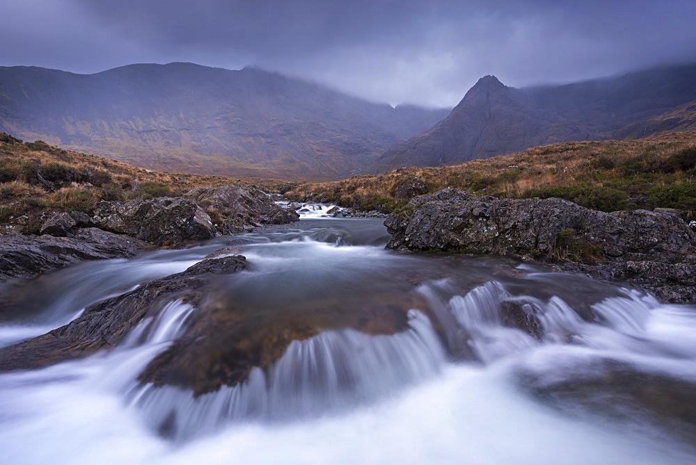 The Fairy Pools beneath the Cuillin Hills mountain range, Isle of Skye, Inner Hebrides, Scotland, United Kingdom, Europe