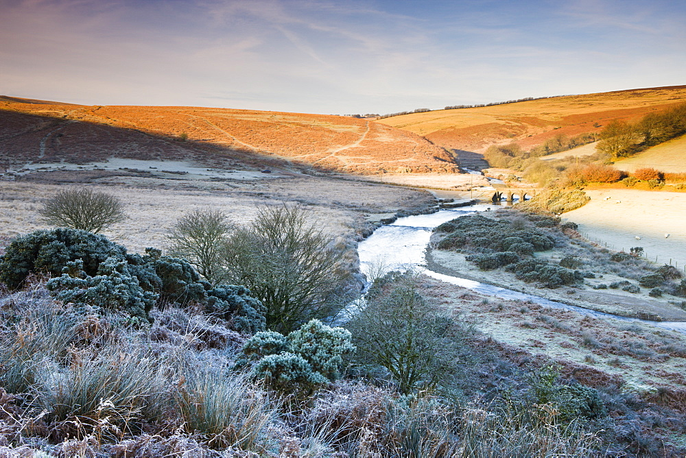 Sunlight thaws the frosted moorland landscape near Landacre Bridge, Exmoor National Park, Somerset, England, United Kingdom, Europe
