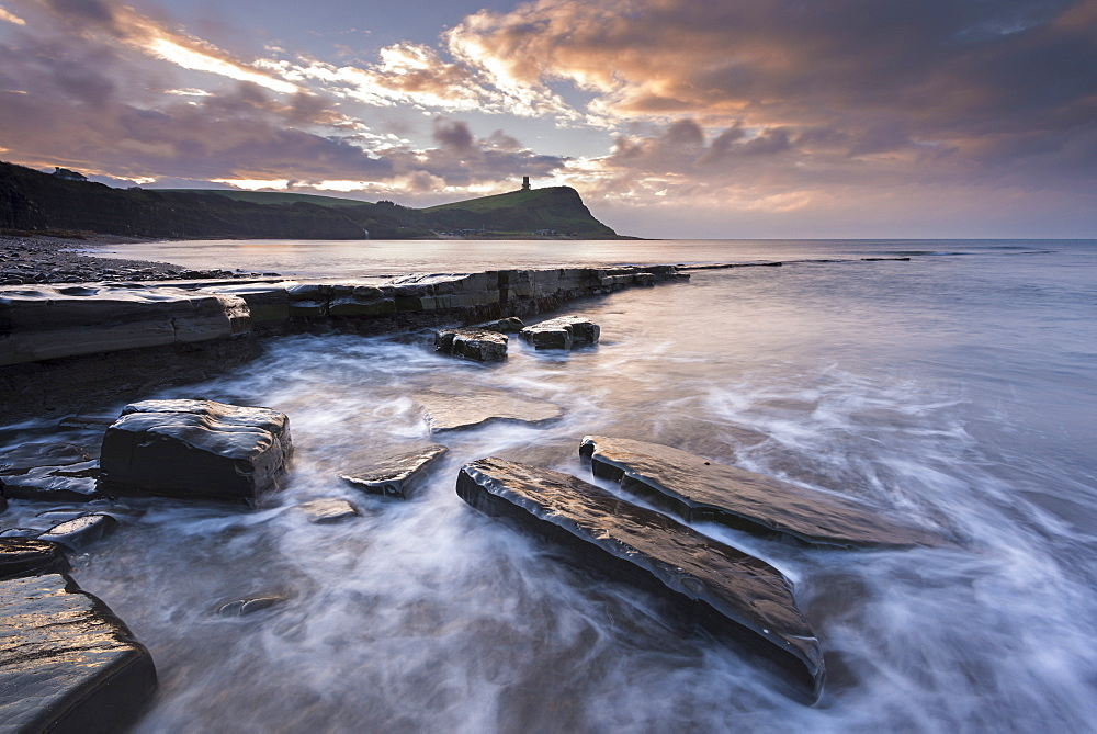 Winter sunrise over Clavell Tower from Kimmeridge Bay on the Jurassic Coast, UNESCO World Heritage Site, Dorset, England, United Kingdom, Europe