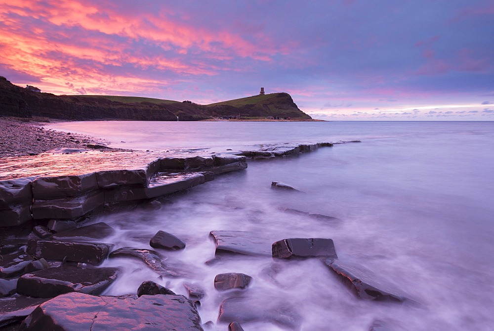 Colourful dawn sky above Kimmeridge Bay in winter, on the Jurassic Coast, UNESCO World Heritage Site, Dorset, England, United Kingdom, Europe