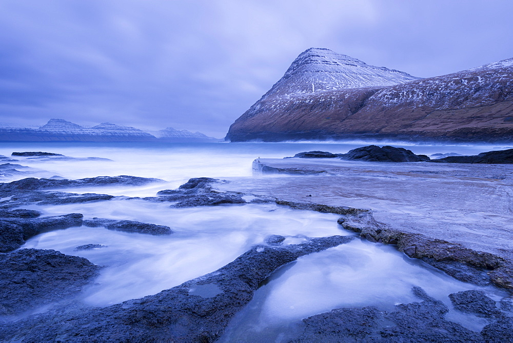 Dramatic coastline of Gjogv in winter on the island of Eysturoy, Faroe Islands, Denmark, Europe
