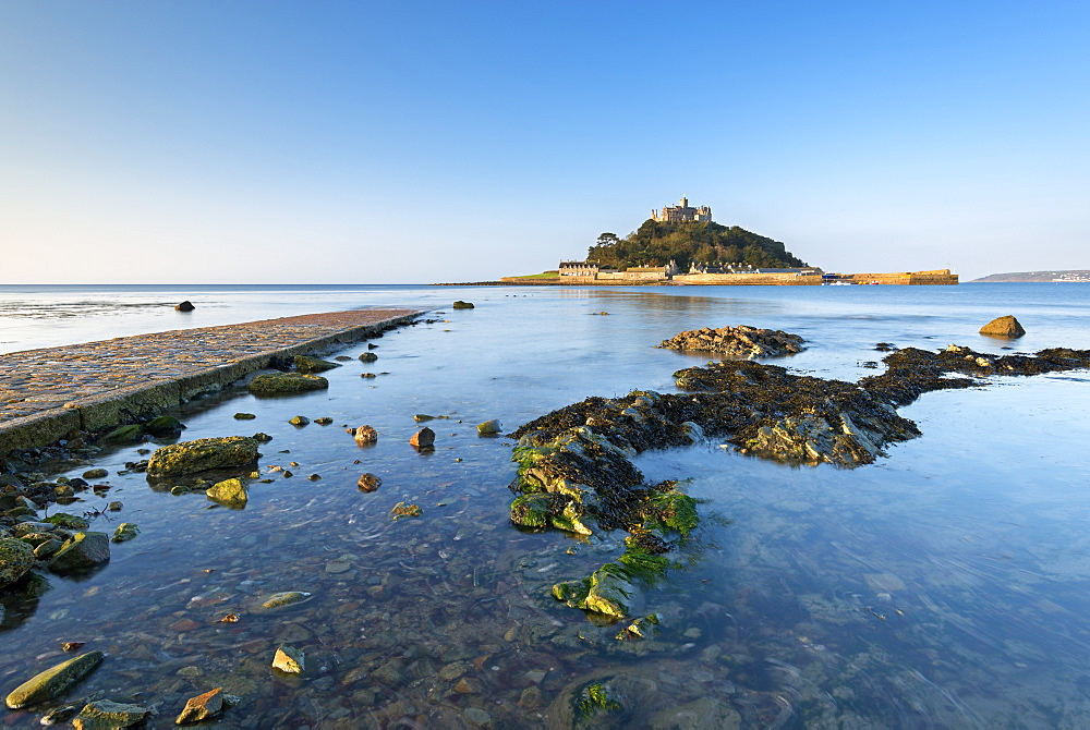 Rising tide floods Mounts Bay and the stone causeway at St. Michaels Mount, Marazion, Cornwall, England, United Kingdom, Europe