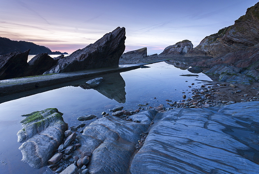 Dusk over Combe Martin beach in Exmoor National Park, Devon, England, United Kingdom, Europe
