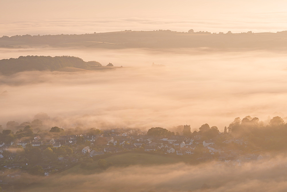 Chagford Church and village surrounded by early morning mist, Dartmoor National Park, Devon, England, United Kingdom, Europe