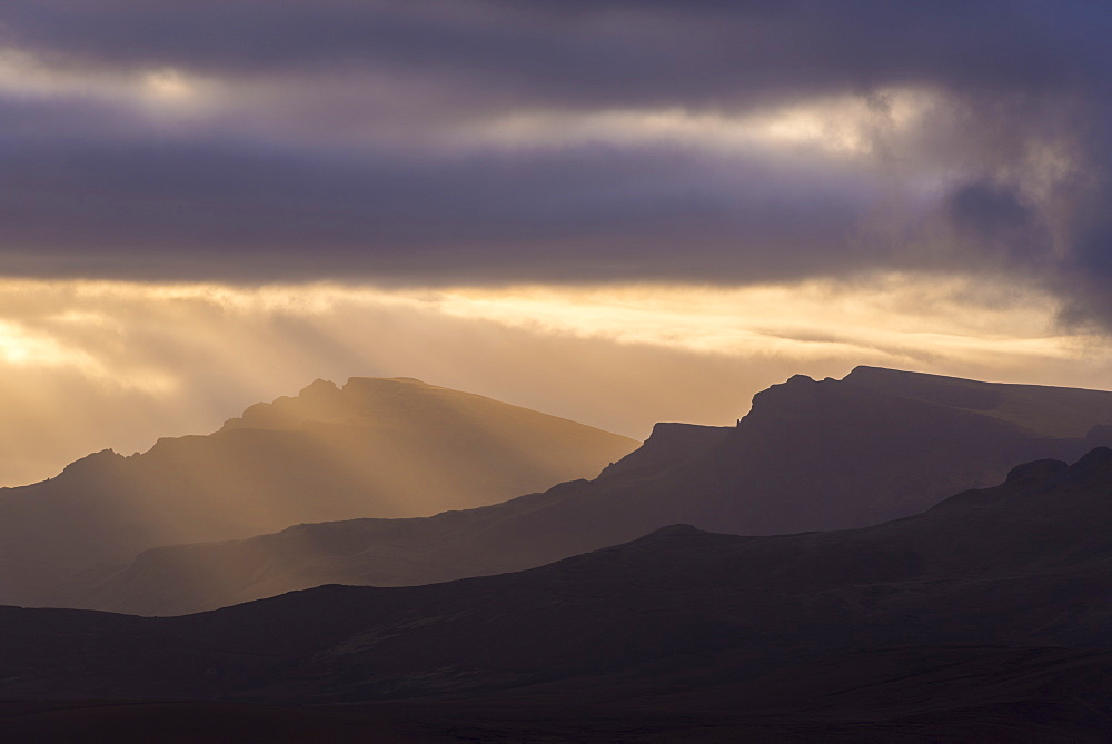 Rich morning sunlight over the Trotternish mountain range, Isle of Skye, Inner Hebrides, Scotland, United Kingdom, Europe