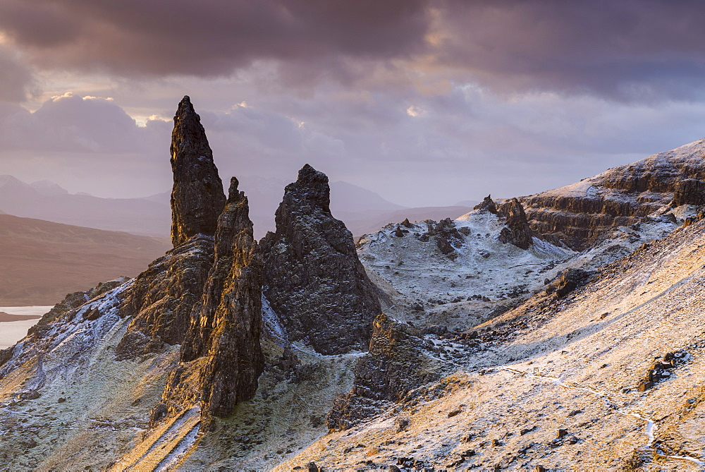 Snow dusted Old Man of Storr at sunrise, Isle of Skye, Inner Hebrides, Scotland, United Kingdom, Europe