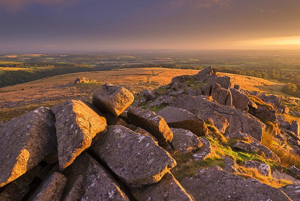 Magical light illuminating Belstone Tor in Dartmoor, Devon, England, United Kingdom, Europe