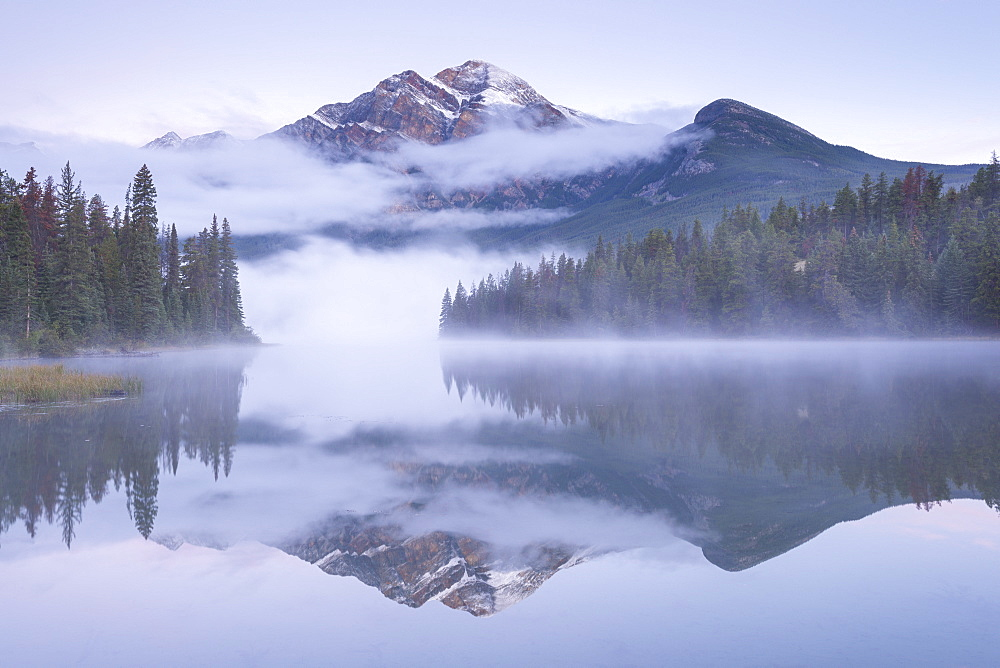 A misty Pyramid Mountain reflected in Pyramid Lake at dawn, Jasper National Park, Canadian Rockies, UNESCO World Heritage Site, Alberta, Canada, North America
