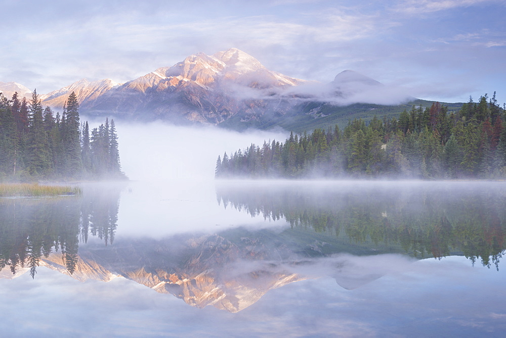 Mist shrouded Pyramid Lake at dawn in the Canadian Rockies, Jasper National Park, UNESCO World Heritage Site, Alberta, Canada, North America