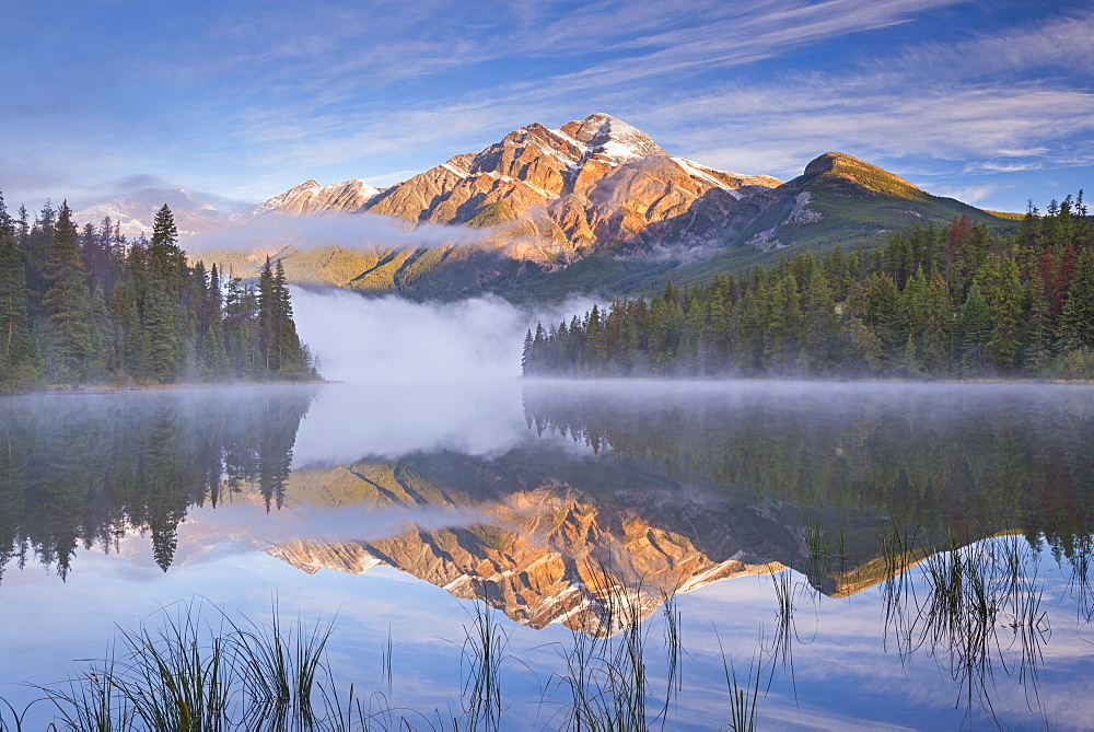 Pyramid Mountain reflected in Pyramid Lake at dawn on a misty morning, Jasper National Park, UNESCO World Heritage Site, Alberta, Canada, North America