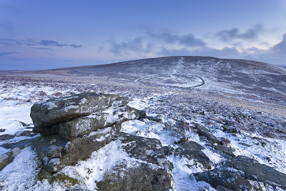Snow dusted Bronze Age settlement of Grimspound from Hookney Tor, Dartmoor, Devon, England, United Kingdom, Europe