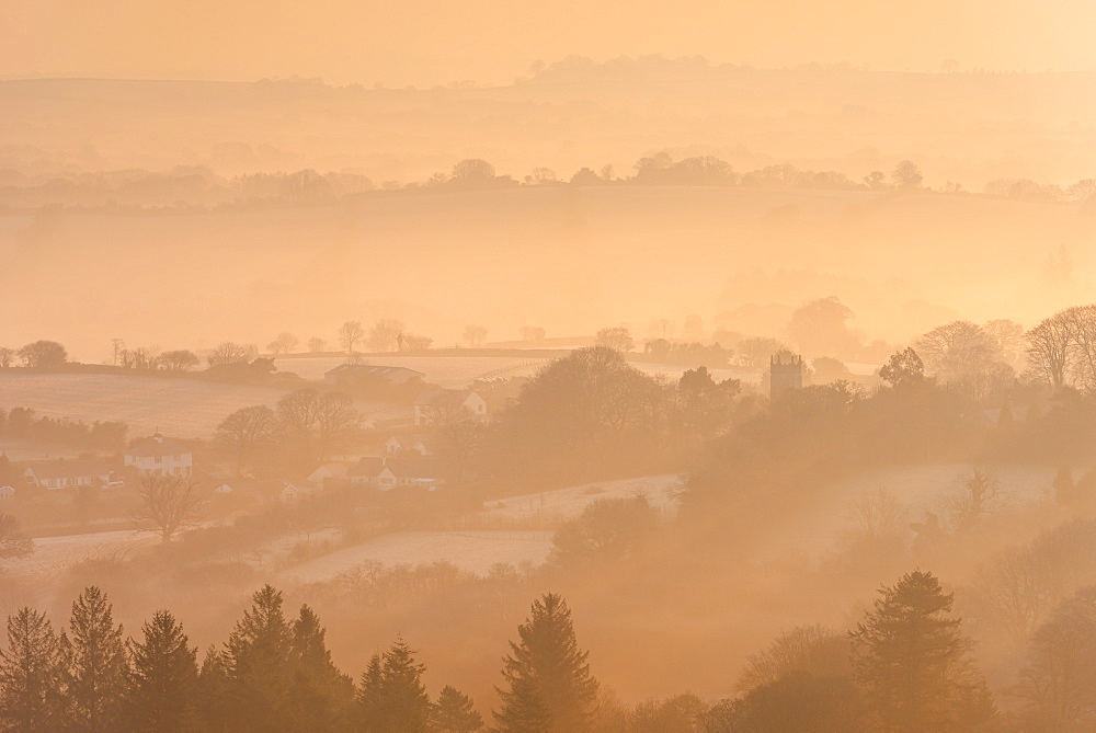 Misty and frosty winter sunrise over Dartmoor countryside near Throwleigh, Devon, England, United Kingdom, Europe