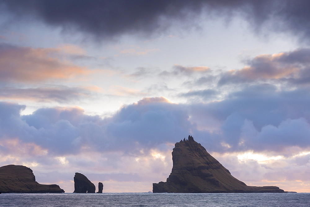 Dramatic outline of Tindholmur island at sunset, Vagar, Faroe Islands, Denmark, Europe