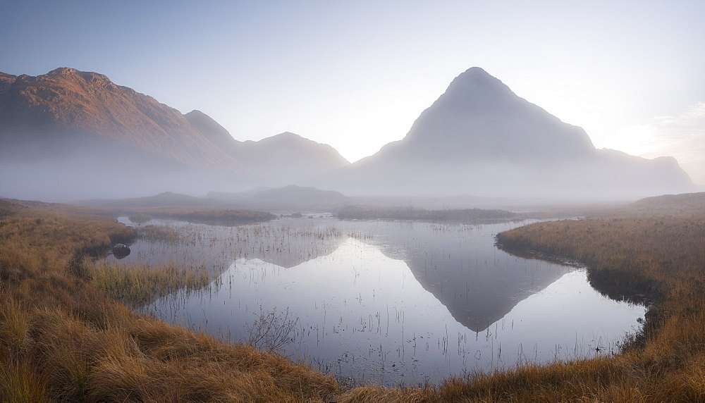 Evening mist shrouds Buachaille Etive Beag mountain on Rannoch Moor, Highland, Scotland, United Kingdom, Europe