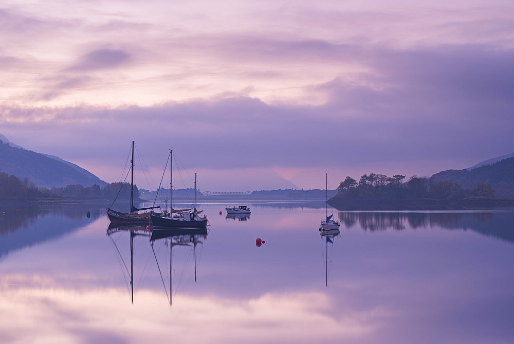 Yachts moored on a tranquil Loch Leven at twilight, Glencoe, Highland, Scotland, United Kingdom, Europe
