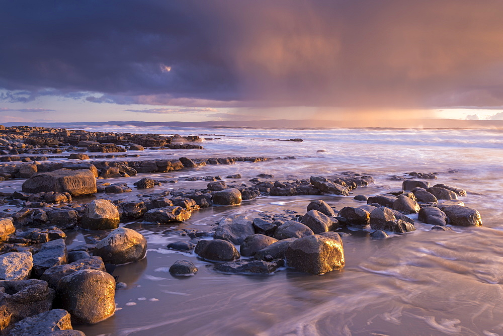 Stormy clouds in winter over the Bristol Channel at sunset, Nash Point, Glamorgan, Wales, United Kingdom, Europe