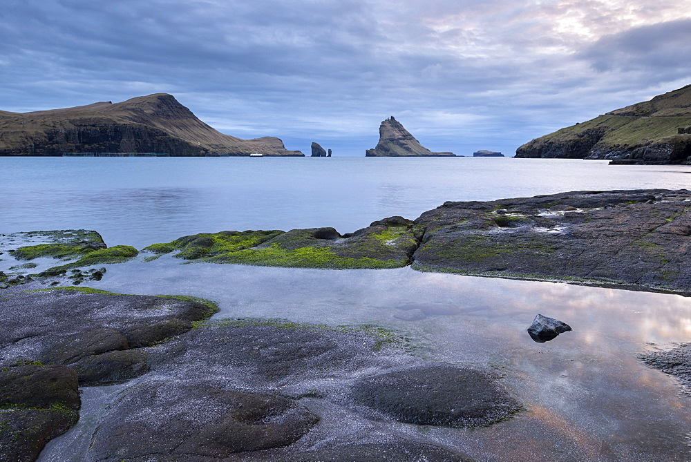 View towards Tindholmur from the rocky shores of Bour, Vagar, Faroe Islands, Denmark, Europe