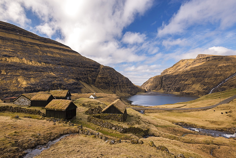 Grass roofed buildings in the beautiful Saksun village on the island of Streymoy, Faroe Islands, Denmark, Europe