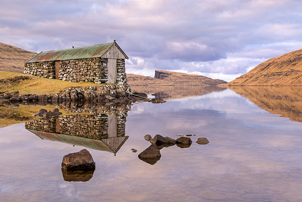 Stone boathouse on Sorvagsvatn (Leitisvatn Lake) on the island of Vagar in the Faroe Islands, Denmark, Europe
