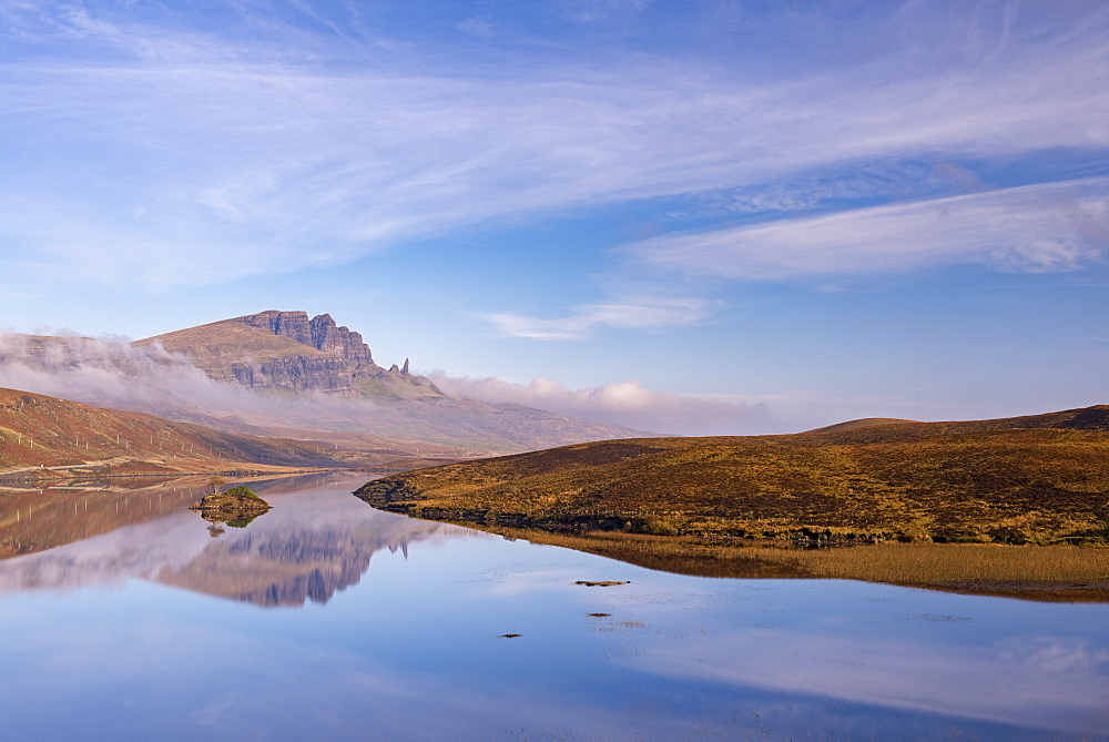 The Old Man of Storr reflected in a mirror still Loch Fada, Isle of Skye, Inner Hebrides, Scotland, United Kingdom, Europe