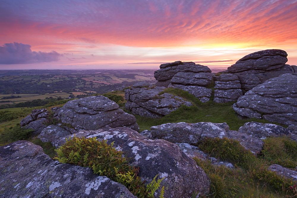 Pink dawn sky above Meldon Hill, Dartmoor National Park, Devon, England, United Kingdom, Europe