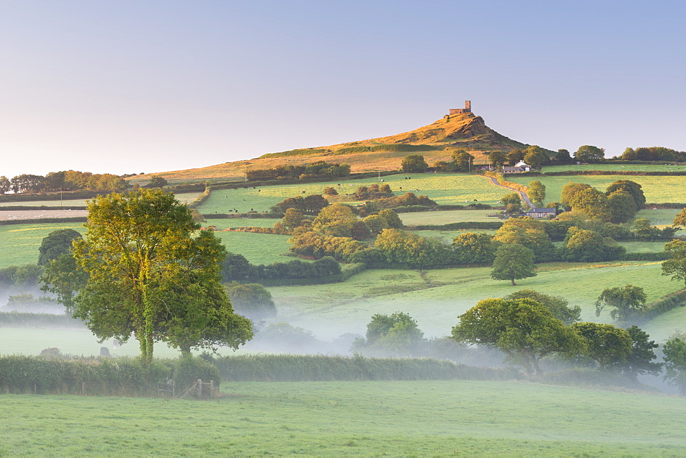 Early morning mist in the rolling farmland below Brentor at dawn, Dartmoor National Park, Devon, England. Summer (August) 2015. - 799-3331