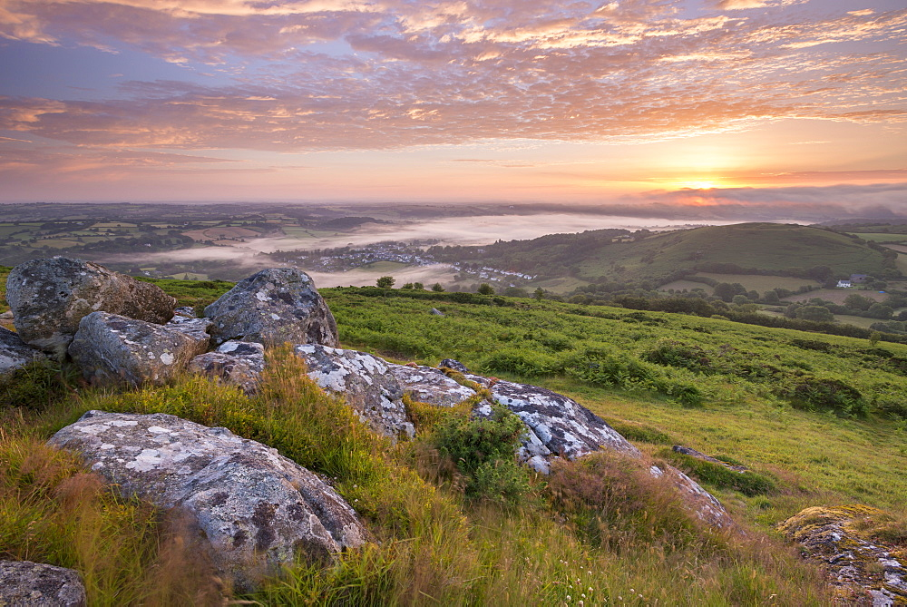 Granite outcrop on Meldon Hill at sunrise, Dartmoor, Devon, England. Summer (July) 2015.