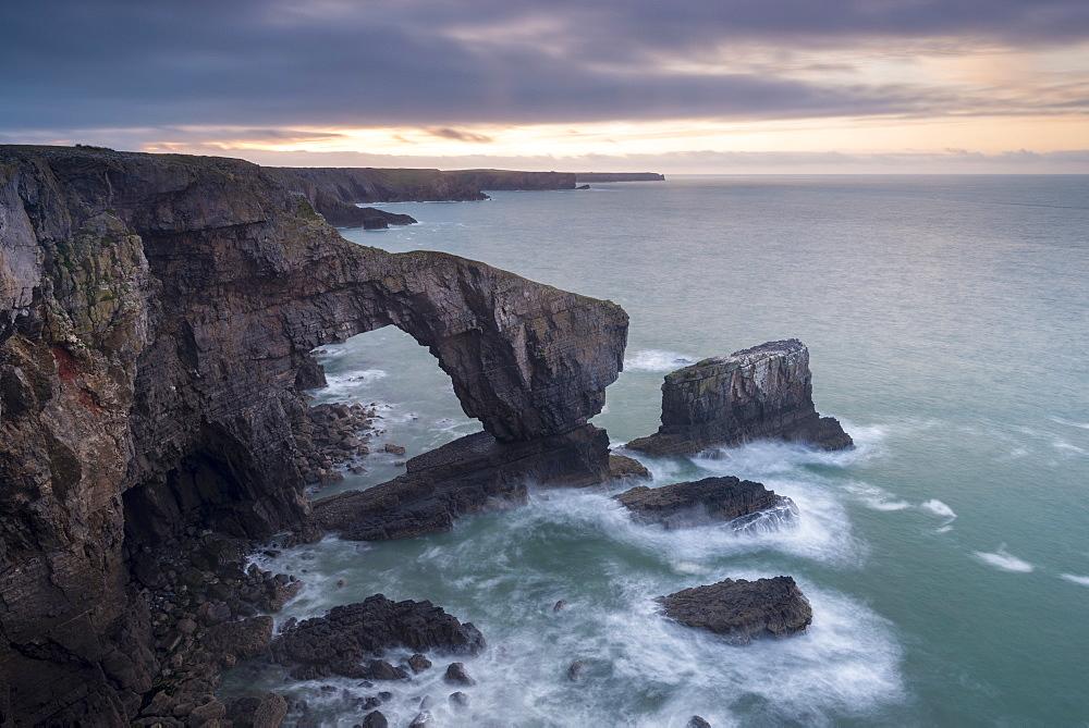 Sunrise over the Green Bridge of Wales, Castlemartin, Pembrokeshire, Wales, United Kingdom, Europe
