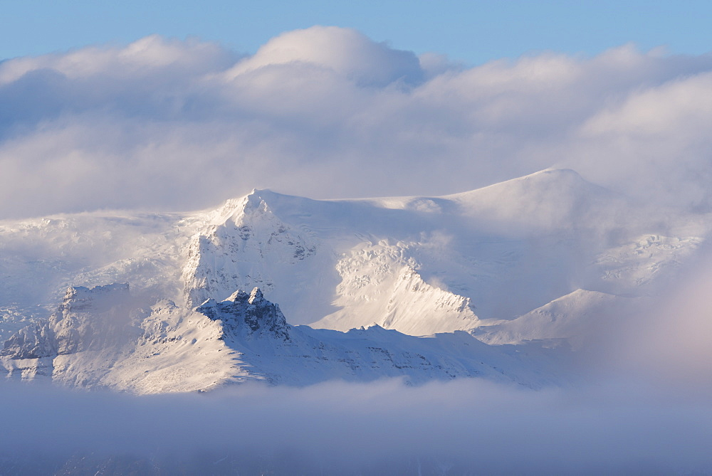 Snow covered mountains appearing through clouds, Iceland, Polar Regions - 799-3437