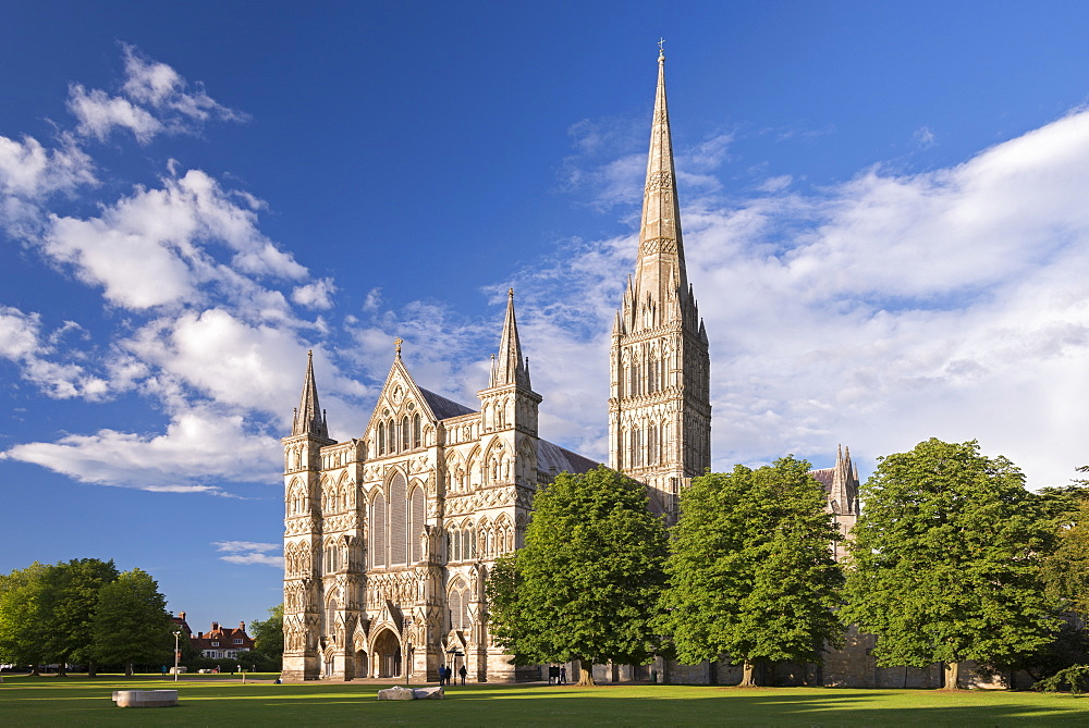 Evening sunshine glows on the ornate facade of Salisbury Cathedral, Salisbury, Wiltshire, England, United Kingdom, Europe