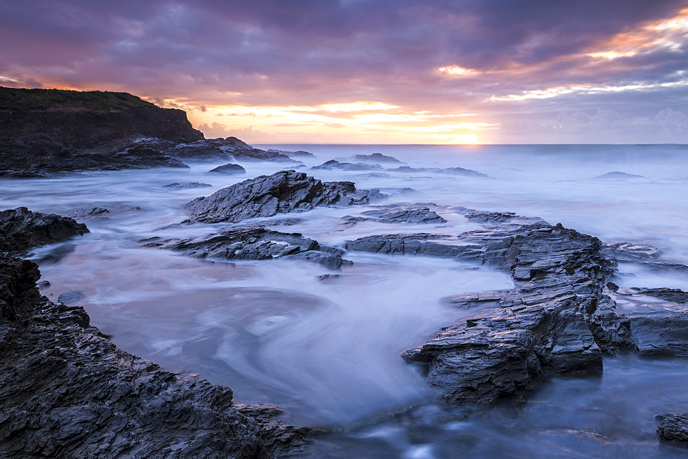 Sunset over the Atlantic from the rocky shores of Booby's Bay, Cornwall, England, United Kingdom, Europe - 799-3450