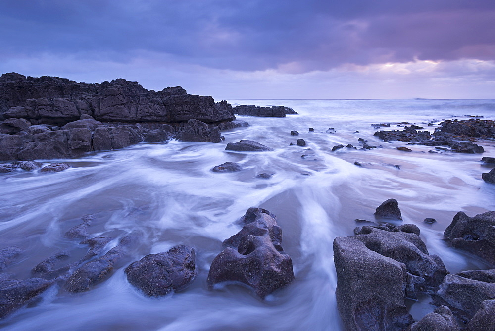 Sunset off the rugged coastline of Porthcawl on the Glamorgan coast, Wales, United Kingdom, Europe - 799-3453