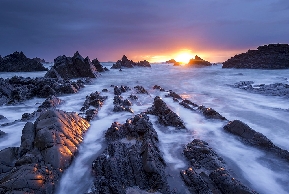 Dramatic sunset over the rocky ledges of Hartland Quay, Devon, England, United Kingdom, Europe - 799-3454
