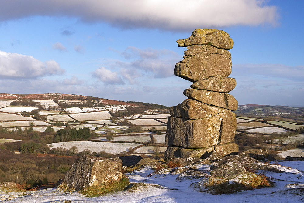 The Bowerman's Nose granite pillar surrounded by light winter snow, Dartmoor, Devon, England, United Kingdom, Europe