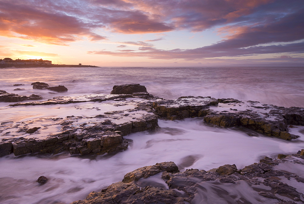Colourful sunrise over the rocky shores of Porthcawl, Glamorgan, Wales, United Kingdom, Europe