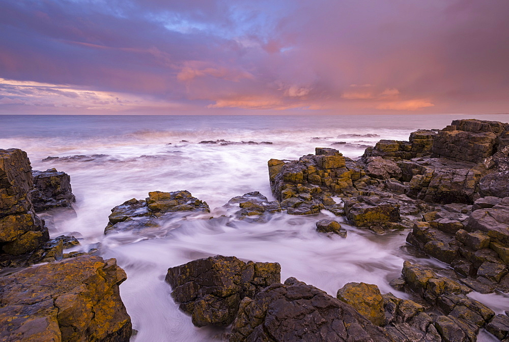 Waves crashing against rocks at sunrise in winter, Porthcawl, Glamorgan, Wales, United Kingdom, Europe