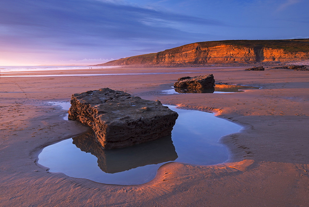 Winter light glows against the cliffs of Dunraven Bay on the Glamorgan Heritage Coast, Wales, United Kingdom, Europe - 799-3547