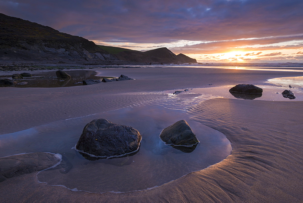 Sunset over a deserted sandy beach in winter at Crackington Haven in North Cornwall, England, United Kingdom, Europe - 799-3556