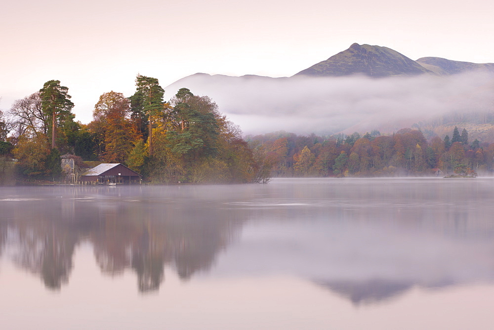 Boathouse on a misty Derwent Water in autumn, Lake District National Park, Cumbria, England, United Kingdom, Europe