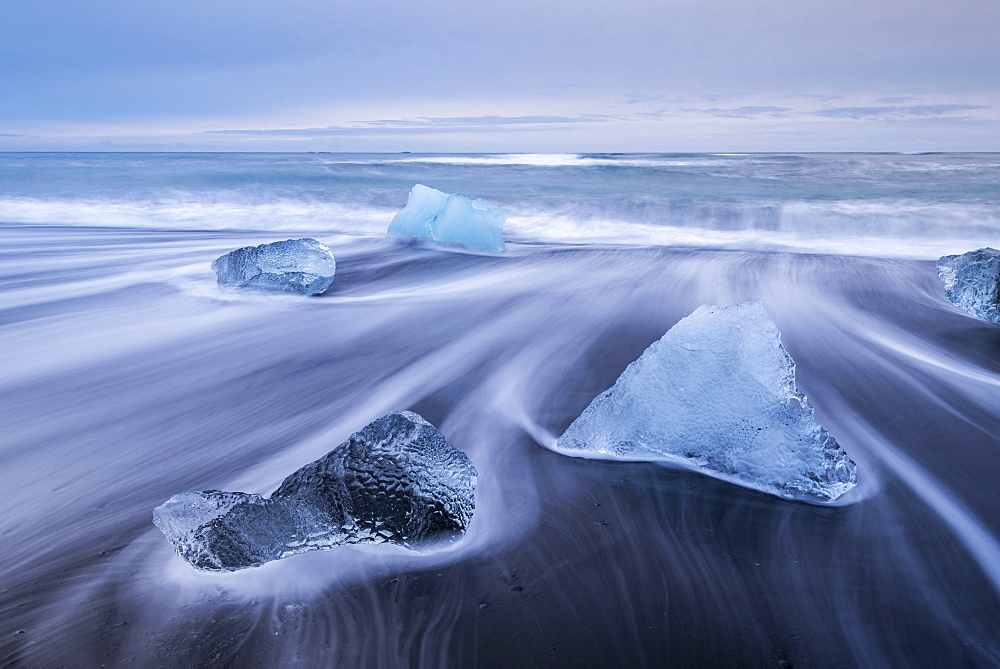Icebergs washed ashore on the black sand beach at Jokulsarlon, Iceland, Polar Regions