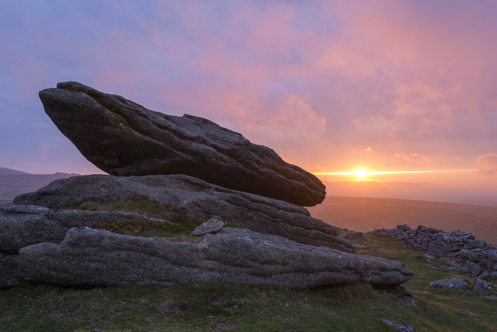 Colourful sunset over a granite logan stone on Belstone Tor, Dartmoor, Devon, England, United Kingdom, Europe - 799-3562