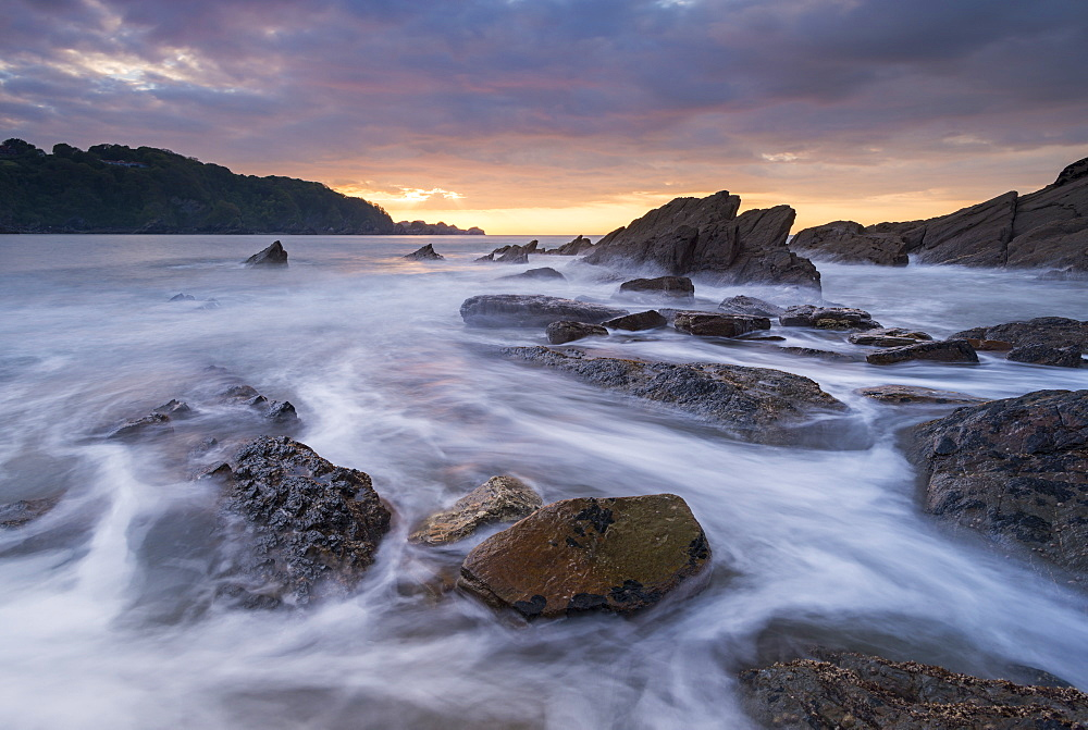 Sunset over the rocky shores of Combe Martin on the Exmoor coast, Devon, England, United Kingdom, Europe