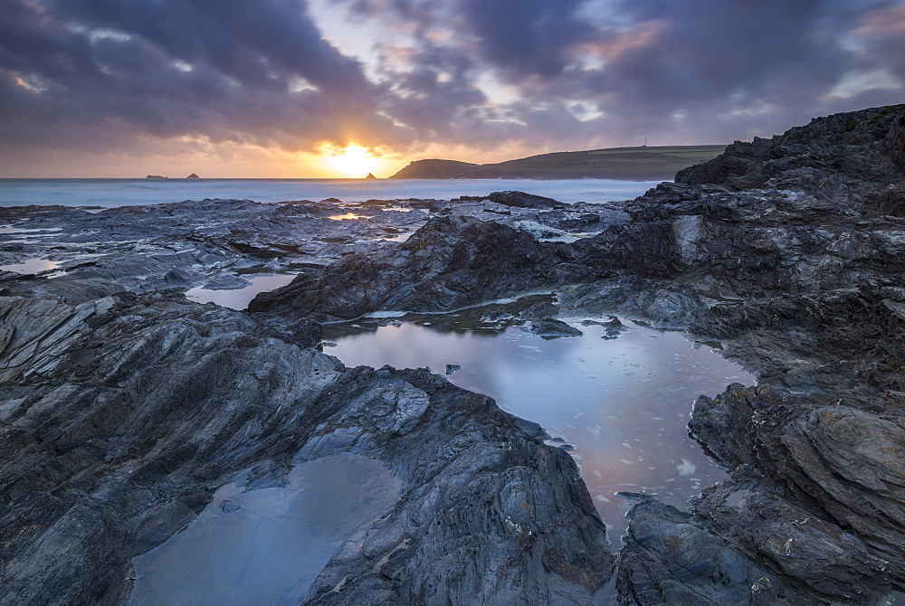 Sunset over Trevose Head, from the rocky shores of Booby's Bay, Cornwall, England. Summer (June) 2017.
