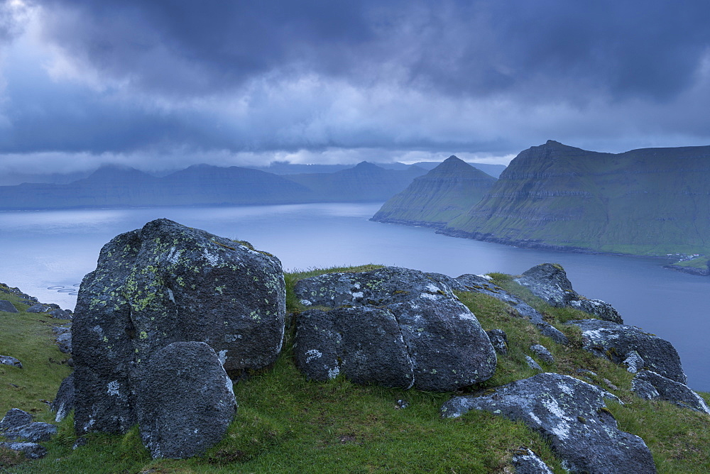 Stormy skies over Funningsfjordur at dawn, Eysturoy, Faroe Islands, Denmark, Europe