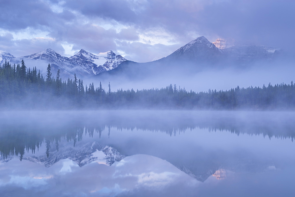 Canadian Rockies and mist reflected in Herbert Lake at sunrise, Banff National Park, UNESCO World Heritage  Site, Alberta, Canada, North America - 799-3624