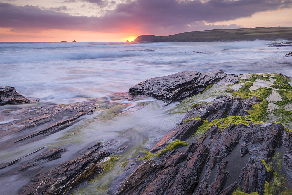 Waves crash against the rocky shores of Boobys Bay at sunset, Cornwall, England, United Kingdom, Europe - 799-3630