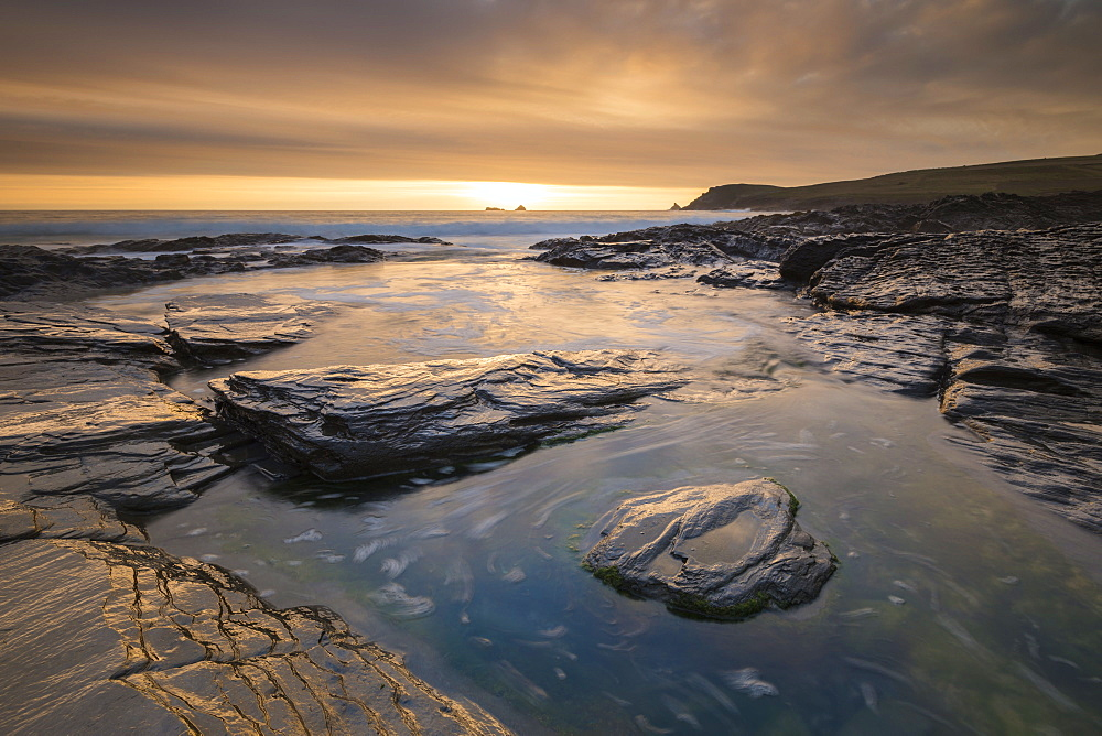 Spectacular golden sunset above the rocky shores of Boobys Bay near Trevose Head, Cornwall, England, United Kingdom, Europe